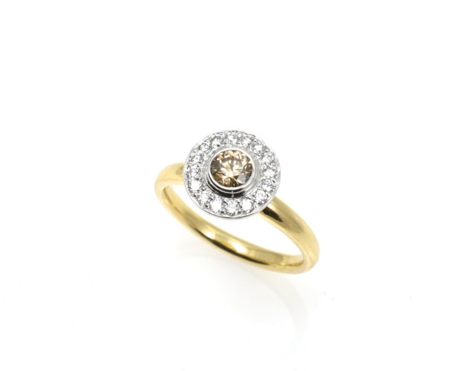 Gabriel,diamond .60ct total, champagne Diamond centre stone .30ct,18k yellow and white gold halo (solid). Price includes shipping insurance