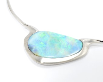 Natural Australian  bolder opal , set in a 9ct white gold necklace.