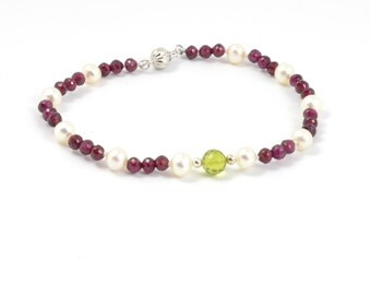 Fresh water pearls, Natural garnet and peridot. Availadle inSterling silver or 9K yellow gold (solid).