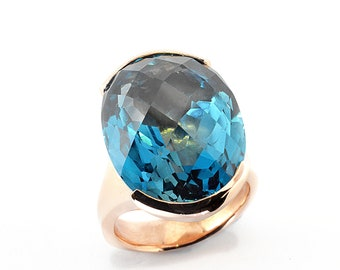 24ct Topaz London Blue 20mmx15mm in 9K pink gold,9gm of solid gold a fabulous ring classic modern design.Price includes shipping insurance.