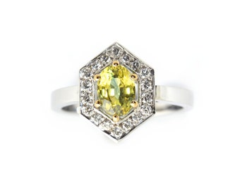 Yellow Sapphire 1.90ct,diamonds 25pt,18k white gold (sold),featuring a unique yellow petitioned Sapphire. Price includes shipping insurance.
