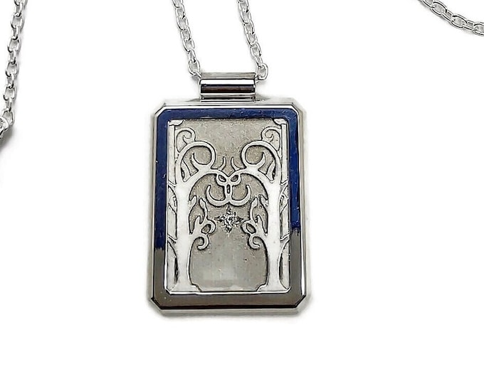 Solid sterling silver with small diamond Elvish based design.Your choice of stg silver chain, leather or satin cord. Can be engraved on back