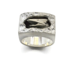 Dragon rock ring solid sterling silver 24gms designed to look as if the dragon was carved directly from the rock as it emerged from a cave.
