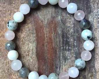 Moon Magic   Moonstone, Sesame Jasper, Labradorite + Rose Quartz   Avg 8 mm   Spiritual Junkies   Yoga + Meditation   Mala Bracelet