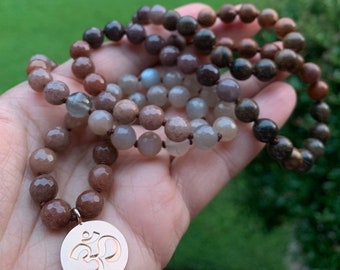 Ommmbre II   Mauve Aventurine, Sunstone, Grey Moonstone, Purple Aventurine, Rosewood + Rose Gold Vermeil Om Mala   108   Spiritual Junkies