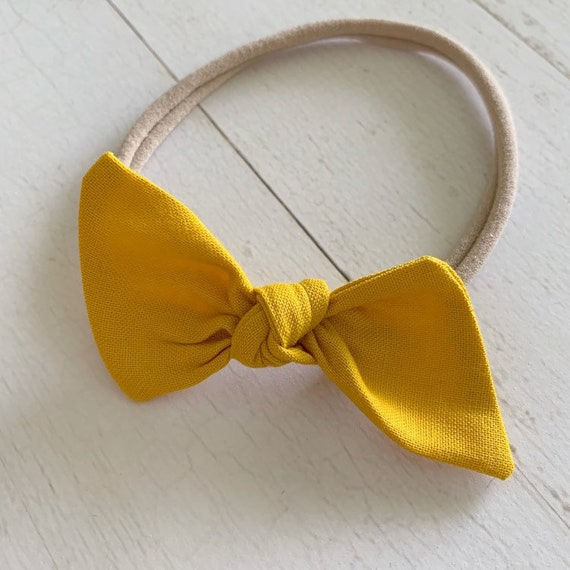 Bitsy knot bow headband {Honey} newborn headbands - baby clothing - mini bows - nylon headbands