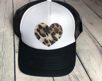 7ad133642d6 Leopard print heart women s trucker hat. SnapBack adjustable