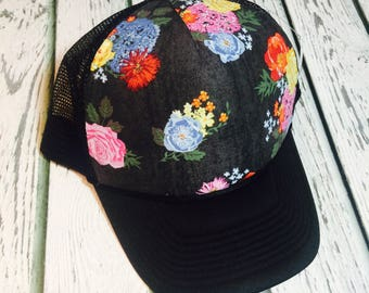 a27fd3423da Best selling deep gray floral design trucker hat available in a variety of  different brim colors and sizes!