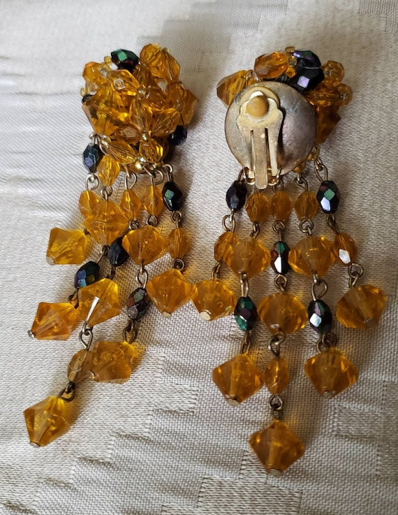 Unsigned Vintage Amber and copper colored beaded clip on earrings Mint condition