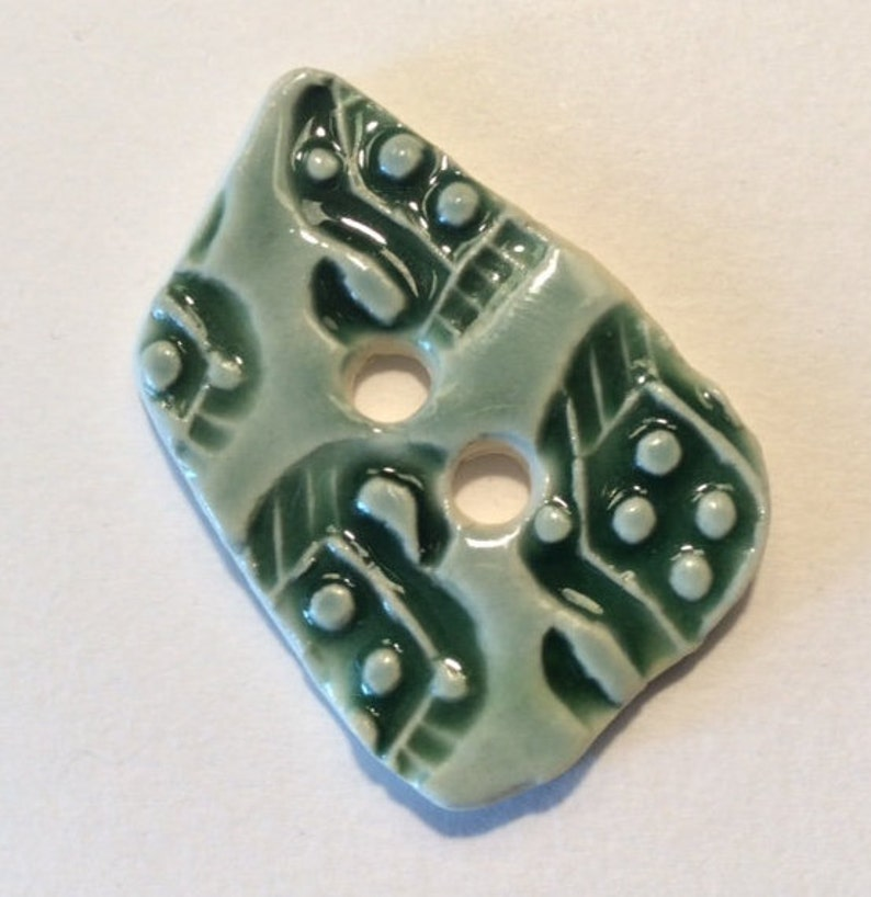 1.5-inch button Unique one of a kind glossy forest green celadon with original motif handmade porcelain ceramic pottery