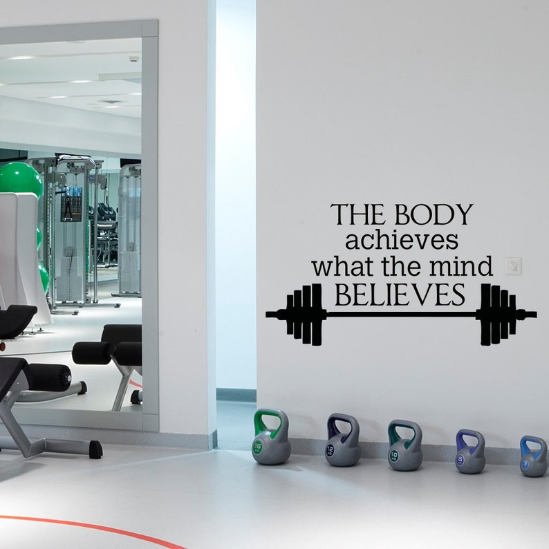 Gym wall decal sports quotes the body achieves what the mind etsy