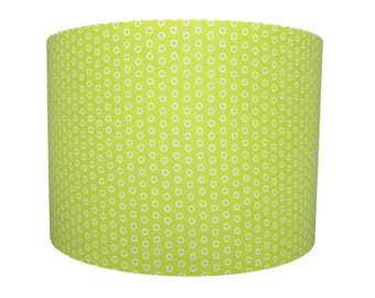 Handmade drum lampshade with white marguerite flowers on a lime green background
