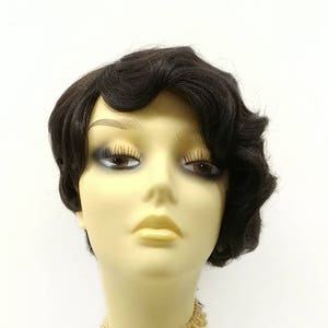 1920s Headband, Headpiece & Hair Accessory Styles 1920s Style Darkest Brown Asymmetric Finger Wave Heat Resistant Wig. Retro Vintage Flapper Gatsby Style Wig. [127-595-Rita-2] $49.95 AT vintagedancer.com