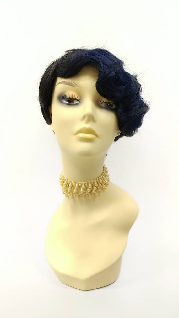 Vintage Hair Accessories: Combs, Headbands, Flowers, Scarf, Wigs 1920s Style Asymmetric Black and Blue Finger Wave Heat Resistant Wig. Retro Vintage Flapper Gatsby Style Wig. [127-598-Rita-TTS/Blue] $49.99 AT vintagedancer.com