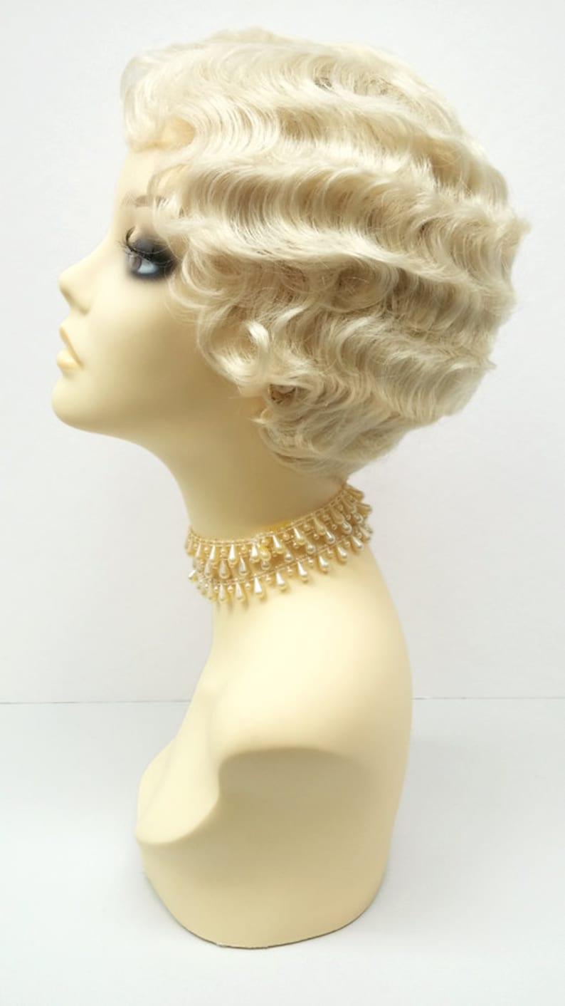 1920s Headband, Headpiece & Hair Accessory Styles 1920s Style Short 613 Blonde Finger Wave Wig. Marcel Wave Vintage Style Costume Wig. Heat Resistant Wig. [69-355-HTBebe-613] $39.99 AT vintagedancer.com