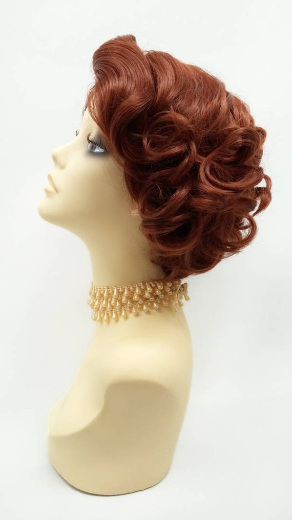 1950s Fashion History: Women's Clothing  Doris Day Style Wig.  Lace Front Short Bright Auburn Retro Curly Wig. Vintage Style Heat Resistant Wig. [72-373-LFDoris-130] $65.99 AT vintagedancer.com