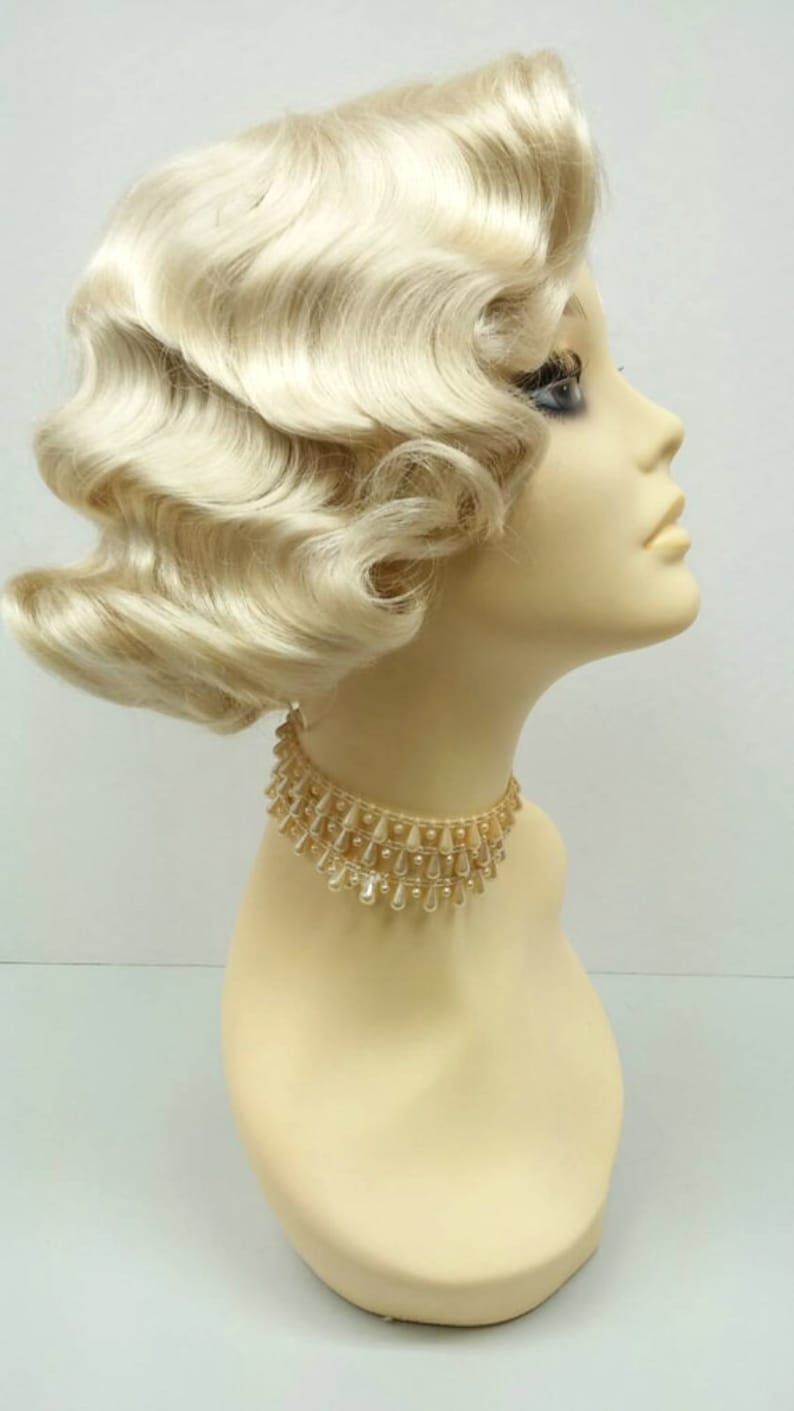 1920s Hairstyles History- Long Hair to Bobbed Hair 1920s Style Short Blonde Finger Wave Wig. Vintage Style Costume Wig. [02-15-Rosie-613] $39.99 AT vintagedancer.com