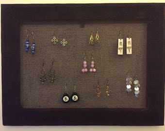 Handmade plum-stained earring display.