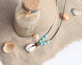 Cowrie necklace with blue and silver beads
