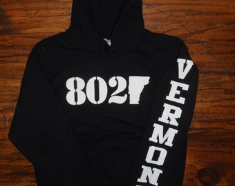 802 Classic Hooded Sweatshirt - White 802 logo on a Black Hoodie with Vermont Printed on the Sleeve