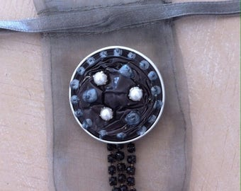 Brooch capsules grey recycled nespresso coffee
