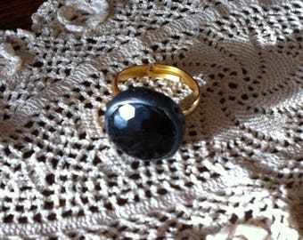 Decorated with a vintage button ring