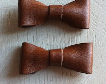 two glossy brown leather knot