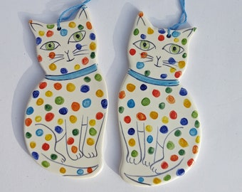 Pair of spotty cat decorations