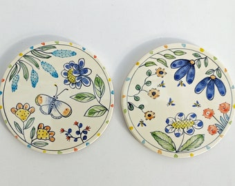 Pair of hand painted ceramic coasters in a gift box.