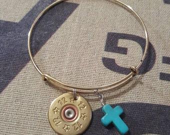 Expandable bangle with 12 gauge shotgun shell and cross charm