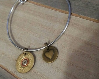 Silver bangle with a 20 gauge shotgun shell and a heart charm