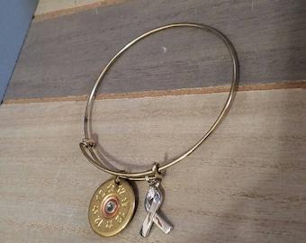Adjustable bangle with a 12 gauge shotgun shell and a awareness ribbon charm