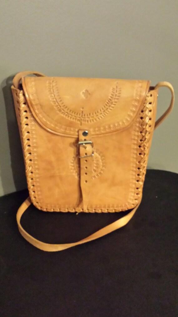 Tooled leather handbag.