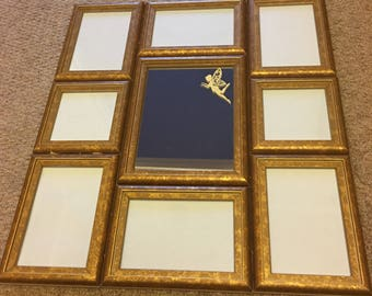 Mirror with photo frames surrounding
