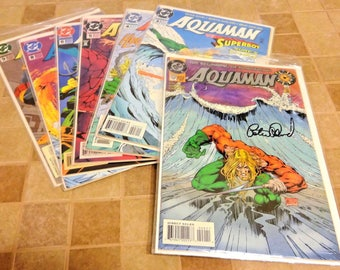 7 Aquaman Comics DC 0 is Autographed by Peter David. Sleeves with Cardboard