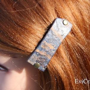 Oval celtic and maori koru design leather barrette with handmade hardwood barrette pin.