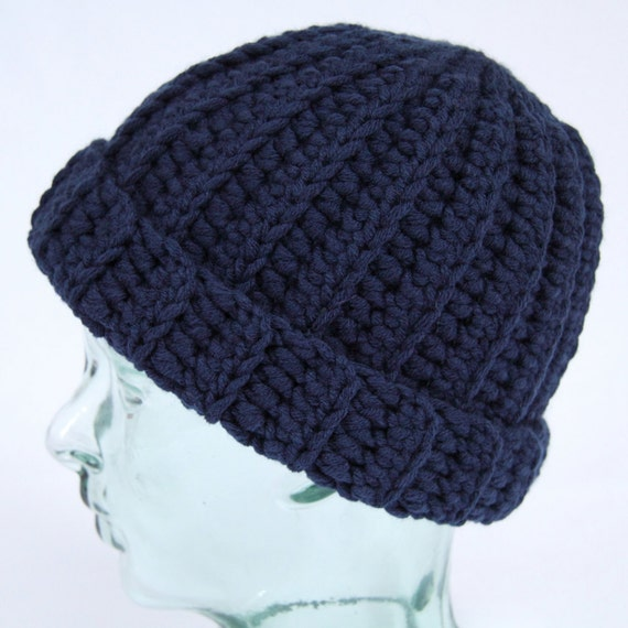 4d00970977c Classic navy blue traditional-style crochet beanie hat.