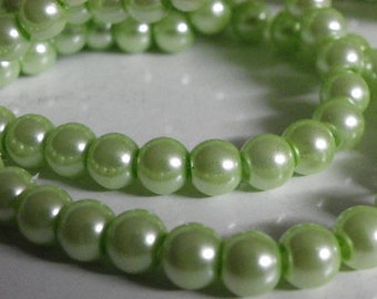 50 beads 10 mm glass Pearl with a beautiful light green