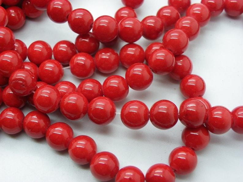 23 jades 8 mm round jade cherry red