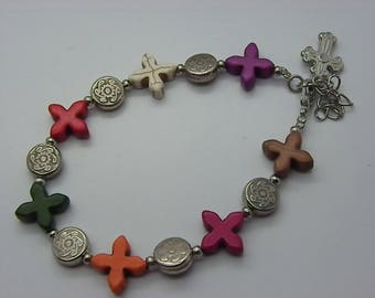 Bracelet with beautiful beads in the shape of crosses or etoilesavec silver charms