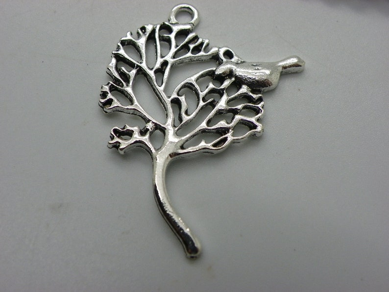 tree of life pendant with a bird 5 cm x 3 cm