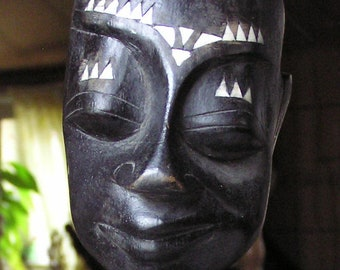 African / Indonesian Black Wood Carving of Seated Boy w Mother of Pearl Inlay
