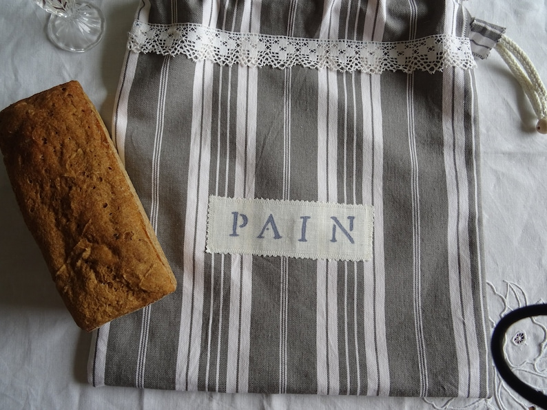 Full-lined vintage grey and white mattress canvas bread bag;