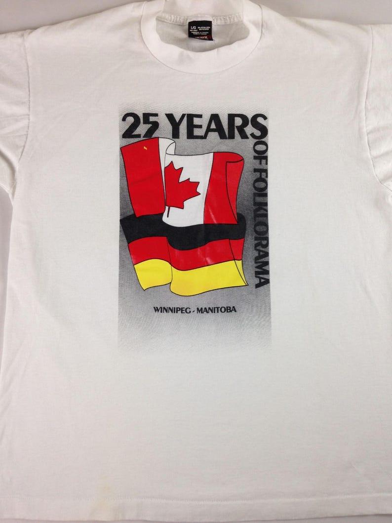 Folklorama T-Shirt 25 Years Adult SZ M/L Winnipeg Manitoba image 0