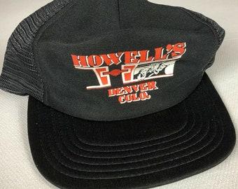 Howell's Construction Snapback Hat Cap Denver Colorado Construction USA Made Adult Mens Trucker One Size Black Orange White