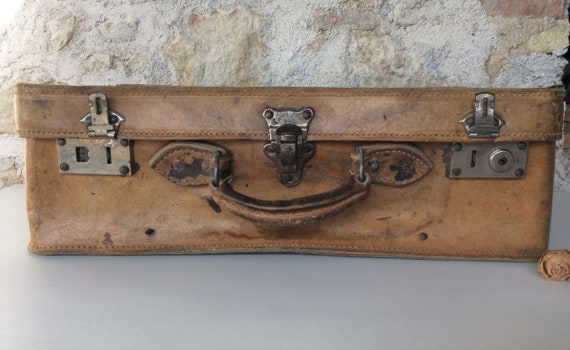 French leather suitcase, a vintage brown suitcase