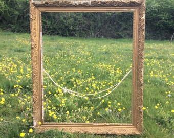 Antique picture frame, a large ornate gold French frame