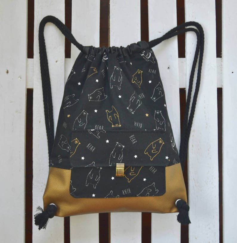 7571f60a97 Backpack in vegan leather and Japanese fabric with