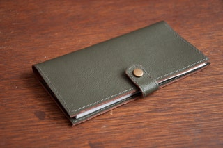 Leather checkbook cover in greyish green