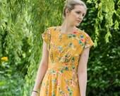 1940s Dress Styles 1940s dress vintage inspired 1940s style golden mustard floral print dress. Made to order in size. $121.84 AT vintagedancer.com